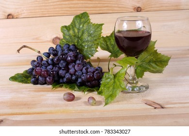 Grape and wine on table