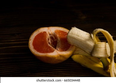 grapefruit and banana with yellow peel on wooden background, sex and sexual intercourse, fruit love, vitamin and dieting, healthy food, penis and vagina