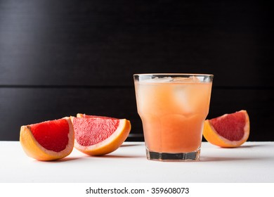 Grapefruit beverage on the wooden background