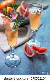 Grapefruit cocktail served in flute glasses.