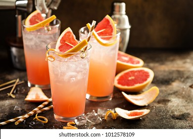Grapefruit cocktail in tall glasses with ice and sparkling water