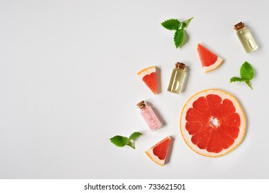 Grapefruit essential oil in small glass bottles. The view from the top. Copy space.