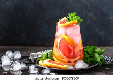 Grapefruit and fresh mint cocktail with juice, cold summer citrus refreshing drink or beverage with ice