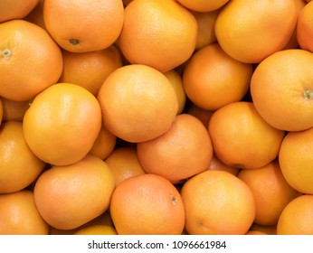 Grapefruit harvest. many grapefruit. grapefruits for food textures and backgrounds. Landscape. A backdrop of grapefruits. Street vegetable market