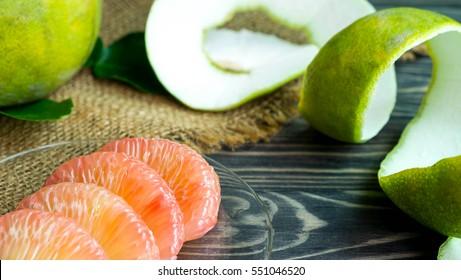 Grapefruit on hemp , Fresh grapefruit and Grapefruit peel on black wood, Orange peel look like cellulite in the women