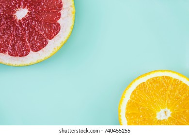 Grapefruit with orange in the corners on cyan background