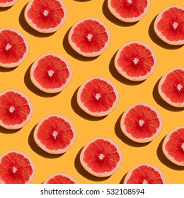 Grapefruit pattern on yellow background. Minimal flat lay concept.