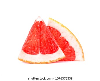 Grapefruit piece isolated on white background. Fresh fruit. With clipping path. Fresh grapefruit with green leaves isolated.