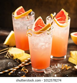 Grapefruit and pineapple cocktail or mocktail, refreshing drink with sparkling water