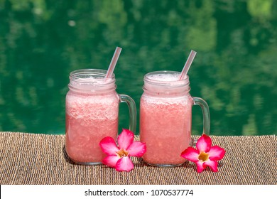Grapefruit pink shake or smoothie on the table, close up. Breakfast in island Bali, Indonesia