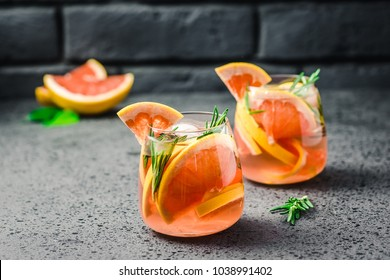 Grapefruit  rosemary gin cocktail on dark concrete background. Selective focus, copy space.