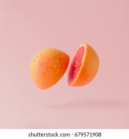 Grapefruit sliced on pastel pink background. Minimal fruit concept.