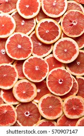 Grapefruit slices background.top view