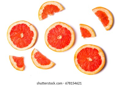 Grapefruit slices isolated on white background top view
