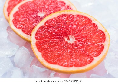 Grapefruit slices on ice. Close-up.