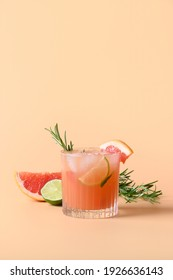 Grapefruit soda with lime garnish rosemary sprig isolated on color background. Mocktail Paloma. Close up. Vertical format.