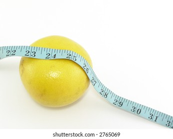 Grapefruit with tape measure - concept of healthy diet