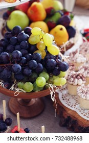 Grapes and apples on fruit holder