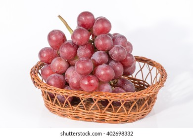 grapes in a basket isolated on white background