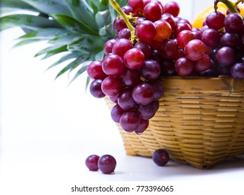 Grapes in a basket on a white background