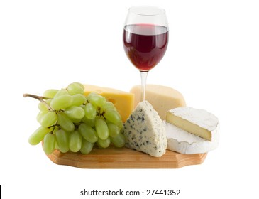 Grapes and cheese with glass of red wine on a white background