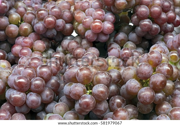 Grapes exposed in open-air market stall in Brazil