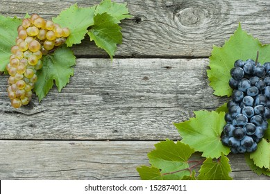 grapes frame, wooden background