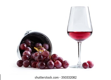 grapes with glass of wine isolated on white background