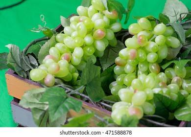 grapes with leaves in a case