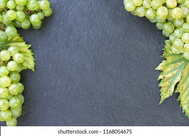 Grapes on a dark stone. Flat lay