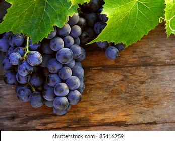 Grapes on a wooden barrel