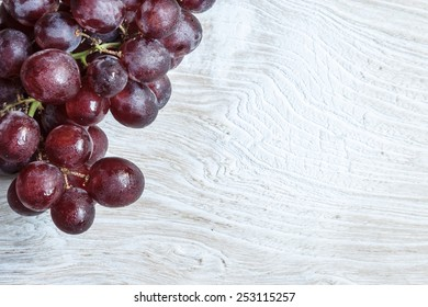 Grapes on wooden board.