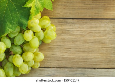 Grapes on a wooden table.