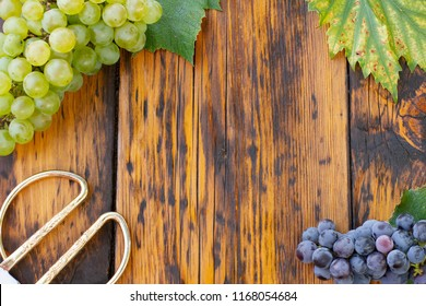 Grapes on a wooden table. Flat lay