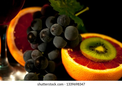 Grapes, orange and kiwi