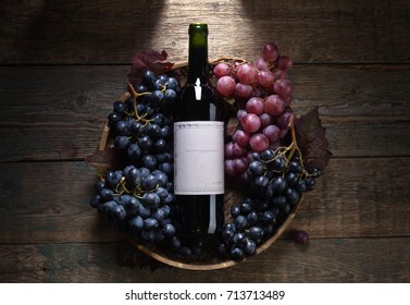 Grapes and red wine. Old paper label , copy space for your text. Top view .