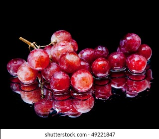 Grapes and splash water over black background