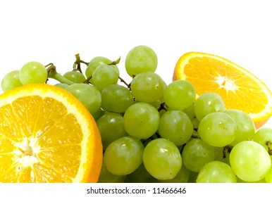 grapes and two halves of orange close-up