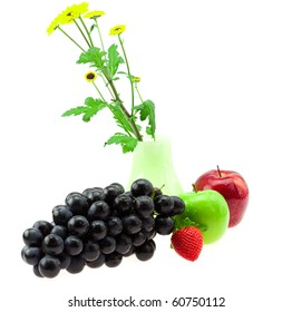 Grapes vase with flowers apples and strawberries isolated on white
