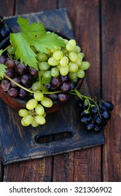 grapes in a wooden bowl, rustic still life