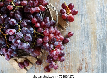 Grapes in a wooden boxon  top view an Old Wooden table