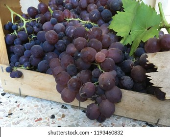 Grapes in wooden crate