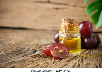 Grapeseed Oil isolated on wooden table.value Crammed with antioxidants and natural plant compounds or virgin cold pressed oil natural.organic cosmetic concept