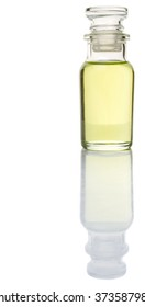 Grapeseed oil in vial glass over wooden background