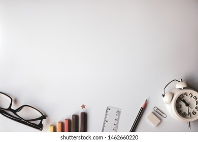 graph , blank space and stationary office on white desk for success , goal business and marketing concept background
