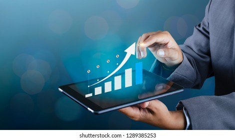 Graph of financial growth global communications Binary Smart Phones and world Internet Business people press the phone to communicate in the Internet Stock chart Researching process.business Team Work
