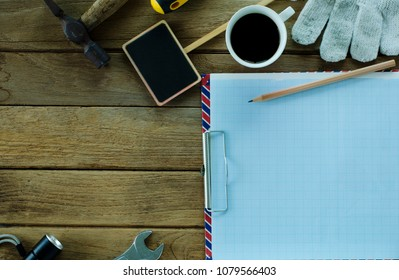 Graph sheet with pencil and equipment tools on wood table backgrounds above