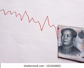 graphic with descending line and chinese banknote of ten yuan
