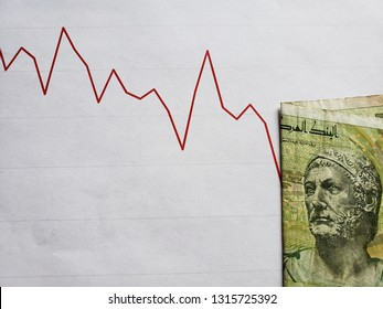 graphic with descending line and tunisian banknote of five dinars