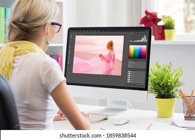 Grafikdesign-Künstler bearbeiten Foto auf dem Computer. Die Benutzeroberfläche der Software ist vollständig zusammengestellt.